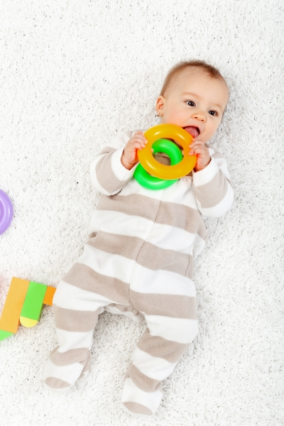 2659327-baby-girl-playing-on-the-floor-chewing-toys